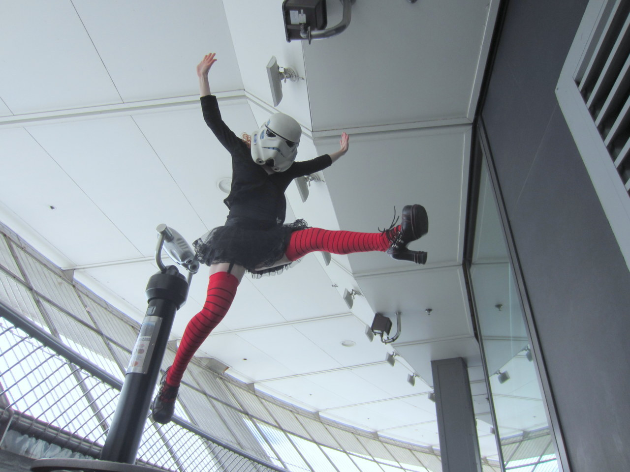 Red jumping in the wind up on the CN tower