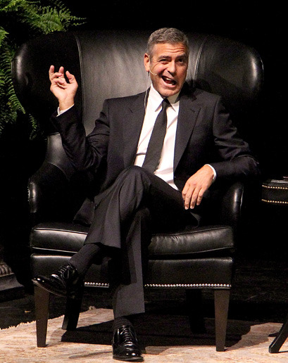 gq:  The Week in Style: George Clooney So now we know what George Clooney's impersonation of a pterodactyl looks like. Cool.