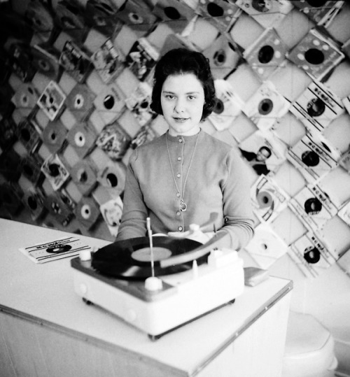 Teenager working at a record store, 1959