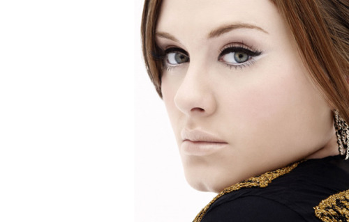 I love the white eyeliner used on Adele in this photo.  It is placed on the bottom waterline and then dragged out and up.