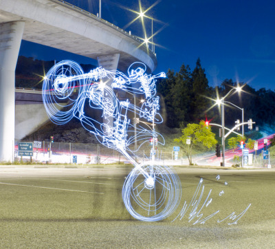 Wheelie light painting by Darren Pearson… it's quite amazing really. This is a 297 second (just under five minute) exposure in which Darren ran into the frame and drew this (freehand) with a light. Can you imagine? Serious props.