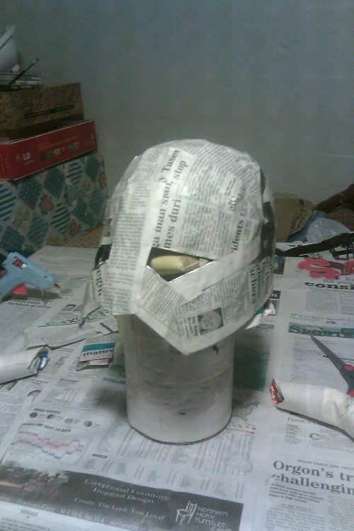 Step 3, first layer of paper mache, of Skyrim helmet 2.0.
