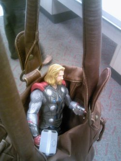 Even the mighty God of Thunder can get tired, so he takes a ride in my purse.