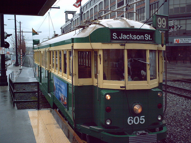 From Times Past on Flickr.Via Flickr: King County Metro's Waterfront Streetcar #605 at Vine Street Station, Seattle, Washington, ca. 2004. King County Metro Transit operated a streetcar in Downtown Seattle between the International District and Pier 70, all along the Seattle Waterfront, using refurbished trams imported from Melbourne, Australia. A ticket to ride the trolley cost the same as Metro's one-zone bus fare, all fare discounts were honored. and all eligible transfers & passes were accepted. Sadly, the Waterfront Streetcar went out of service a year after this picture was taken, due to the Olympic Sculpture Park displacing the maintenance barn for the trolleys. Buses with graphics similar to the streetcar continued to run the route via the streets parallel to the line, but it wasn't the same experience as riding the trolley. Resumption of rail service on the Waterfront Streetcar route is dependent on a new maintenance barn being constructed elsewhere along the line; though planning and construction are at odds with money and politics.