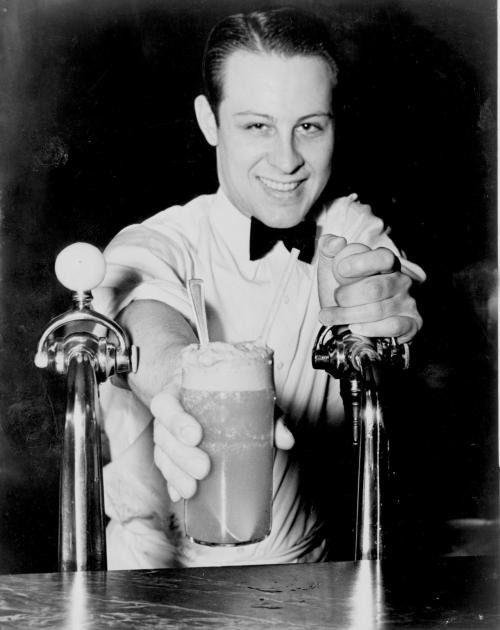 legrandcirque:  Alan Fisher, Soda jerk passing ice cream soda between two soda fountains, 19 December 1936. Source: Library of Congress. New York World-Telegram & Sun Collection