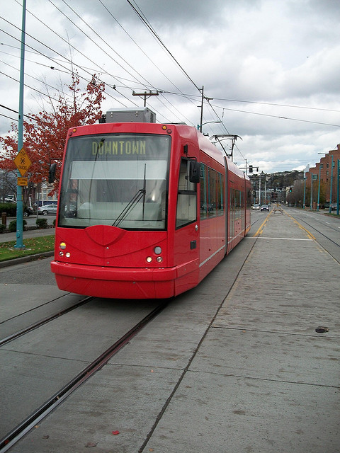 "Ding-Ding! on Flickr.Via Flickr: An Inekon tram operated by the Seattle Streetcar system pulls into Fairview Avenue station from the stub-end before taking it's usual trip to Westlake. The Seattle Streetcar is operated by the City of Seattle's Transportation Department, and is part of the King County Metro Transit system. Financing was provided by Vulcan, Inc., which is owned by software baron Paul Allen. Some locals call the streetcar system the ""SLUT"" for South Lake Union Trolley."