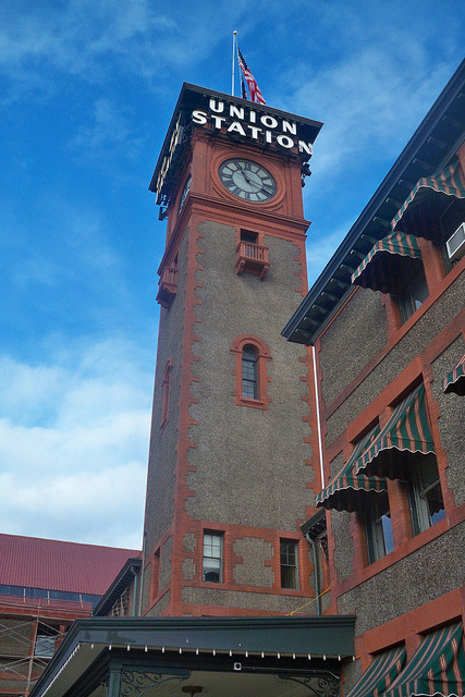 "Il Torre Due on Flickr.Via Flickr: Clocktower of Union Station in Portland, Oregon, which is served by Amtrak's Coast Starlight, Empire Builder, and Amtrak Cascades trains. The neon signs that read ""UNION STATION"" and ""GO BY TRAIN"" are lit up at night."