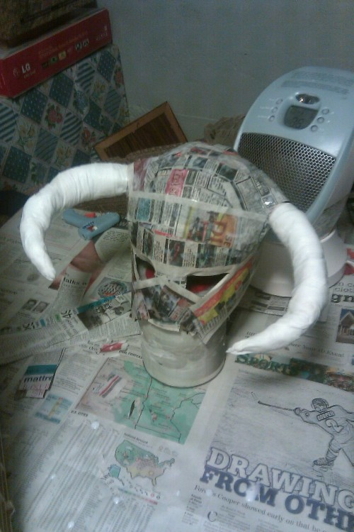 Step 4, horns and second coat of paper mache, of Skyrim helmet 2.0.