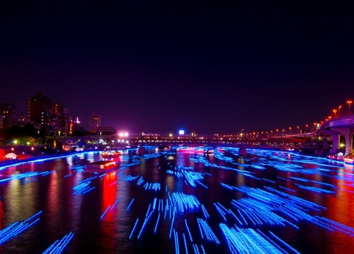 "100,000 LED lights float down the Sumida River, Tokyo Japan. The Tokyo Hotaru Festival 2012 took place recently, releasing 100,000 blue LED lights to float in the Sumida River. The bulbs rolled along the waves of the river bank, mimicking hotaru (the Japanese word for ""fireflies""), for the festival that celebrates the Japanese tradition of watching fireflies float along a watercourse."