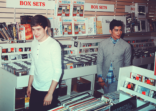 grimmyeatworld:  oh no au where these two work in a record store and zayn wants to categorize everything by 'vibe' rather than genre and he hogs the intercom and sings along to frank ocean and old school usher and liam is basically a babysitter because zayn is singlehandedly running this store into the ground because when customers come in and ask for the latest taylor swift album he just shakes his head and leads them to the slowjam r&b section and liam says things like 'there's a saying zayn and that saying is the customer is always right' and zayn's like 'no shhh here let me sing you some drake though' and liam just lets zayn do what he wants because if he doesn't then zayn won't sing into his neck and liam can't handle that