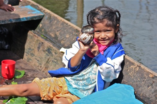 Amazon Girl With Apple Snail from: Peruvian Amazon Day 3 Photo Gallery