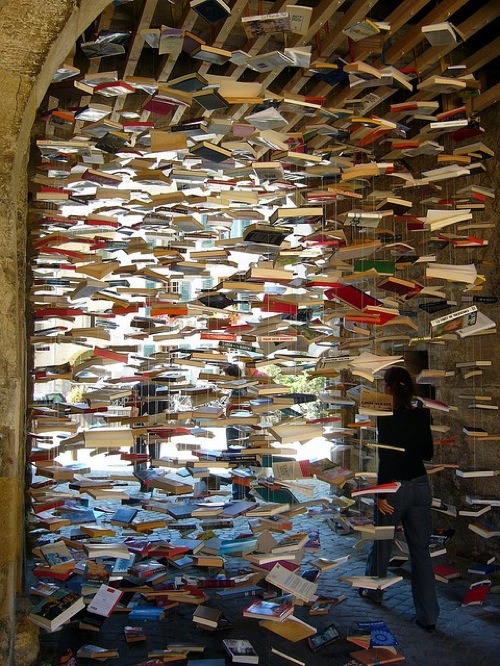 arpeggia:  it's raining books! Foire aux livres, Romainmôtier. Second-hand book fair. Archway between abbey courtyard and main street. Photo by overthemoon