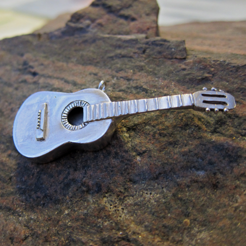 Silver guitar pendant: I've had so much interest about this pendant, I'll make another if someone would like it. Details here: https://www.etsy.com/listing/99675531/silver-guitar-pendant
