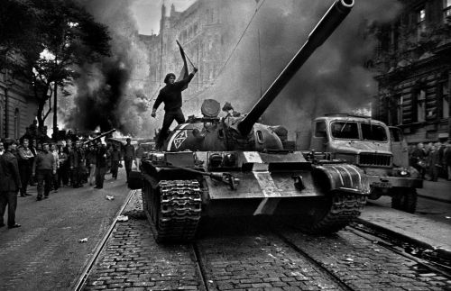 A Czechoslovak citizen standing atop a Soviet tank during the Warsaw Pact invasion of Czechoslovakia. August, 1968.Photo by Josef Koudelka.