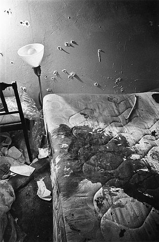Photograph of the apartment of Fred Hampton, after the raid where he was killed by members of the Chicago Police Department. Photo shows large amount of blood on the bed that he was lying in when he was initially shot, and numerous bullet holes in the walls of the room.Fred Hampton (August 30, 1948 – December 4, 1969) was an African-American activist and deputy chairman of the Illinois chapter of the Black Panther Party (BPP). He was killed in his apartment during a raid by a tactical unit of the Cook County, Illinois State's Attorney's Office (SAO), in conjunction with the Chicago Police Department (CPD) and the Federal Bureau of Investigation (FBI).