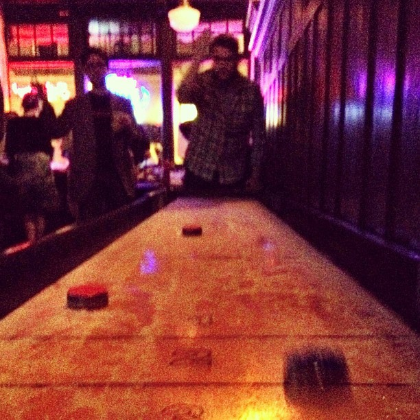 Tabletop shuffleboard at Carly's birthday (Taken with Instagram at Bond Street Bar & Grill)