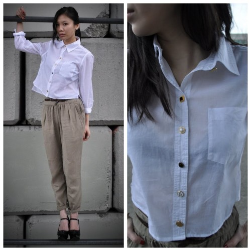 truebluemeandyou:  DIY Simple Cropped White Button Down Shirt Restyle Tutorial. Shorten the hem and replace the buttons. Tutorial from Fashforward here. Photos of cropped button down shirt here.