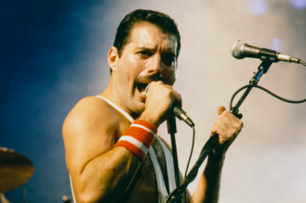 "Another one bites the dust?  emergentfutures:  Queen's Freddie Mercury Will Perform as 'Optical Illusion' Freddie Mercury will make a technology-enhanced appearance from beyond the grave at a tenth anniversary performance of the Queen musical We Will Rock You. But to be clear, the frontman — who died in 1991 — will not be a hologram. He will be an ""optical illusion.""  Full Story: Spin"