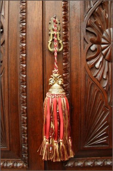 A well-placed tassel - a little piece of luxury inspirationlane:  (via Red French Fleur De Lis Tassel for Antique Furniture : Interior Fittings : The Meadows Antiques and Interiors)
