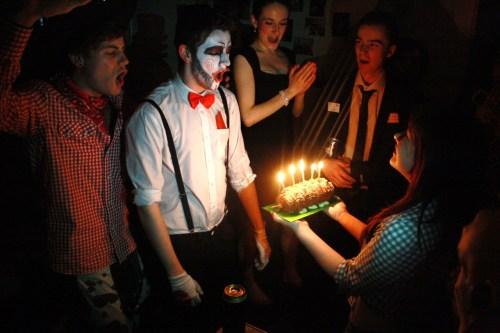 'Peter Pan Fever'An evil clown in a bow tie is presented with his chocolate caterpillar birthday cake by a Toy Story cowgirl. This is not a 5 year old's birthday party as the candles on the cake (and the peculiar costumes) may suggest – it is in fact my fully grown flatmate turning 19. Could it be that we arrived at university and suddenly realised that we are slowly loosing our right to be kids, so we make extravagant attempts to hold onto as much of our childhood as possible?Or possibly the simple fact that parties for 5 year olds are genuinely more fun!