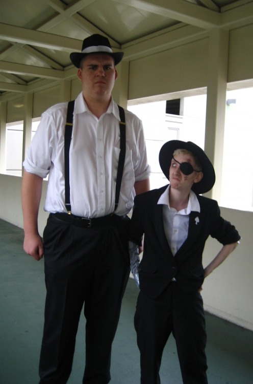 "chotpot:  A picture of me next to Colt. He is 7'1"" in those shoes. I am 5'1"". Accurate height differences ftw.  holy moly"