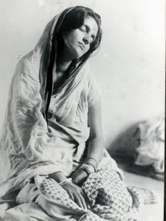 "intheflowersss:  Sri Anadamayi Ma   Blissful Mother in Nirvikalpa Samadhi  ""Who is it that loves and who that suffers? He alone stages a play with Himself; who exists save Him? The individual suffers because he perceives duality. It is duality which causes all sorrow and grief. Find the One everywhere and in everything and there will be an end to pain and suffering."""