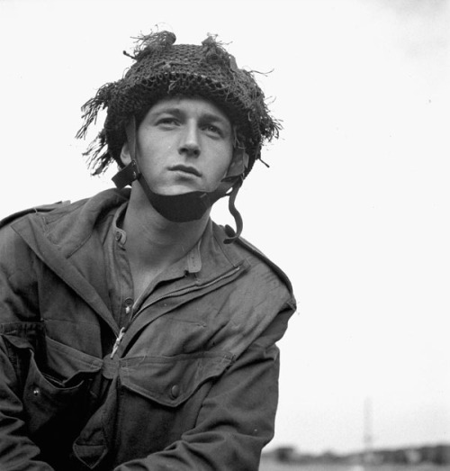 Trooper of 1st Canadian Parachute Battalion, 6th British Airborne Division. I love the look on his face. So serene and wistful even in the midst of the chaos.