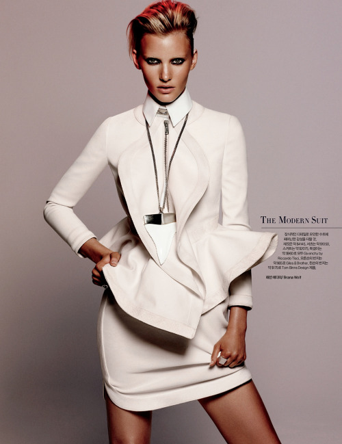 Emily Baker poses for the May issue of Harper's Bazaar Korea, lensed by Daniel Jackson and styled by Brana Wolf.         Original Article
