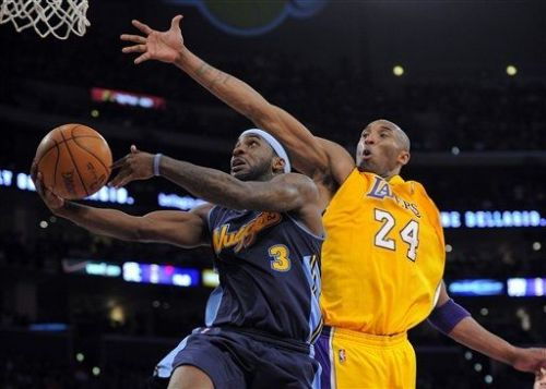 Denver Nuggets guard Ty Lawson, left, goes up for a shot as Los Angeles Lakers guard Kobe Bryant defends during the second half in Game 7 in their first-round NBA basketball playoff series.