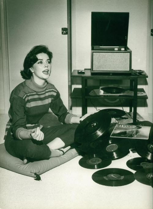 updownsmilefrown:  Natalie Wood with her Elvis records by Murray Garrett