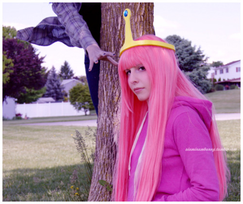 "Me in my Princess Bubblegum cosplay from episode ""Video Makers"". I wore this Friday at Zenkaikon. Marceline is creepin' behind the tree ^^ More pics to come. We did a tiny photoshoot at a playground next to my in-laws house before heading out to the con."