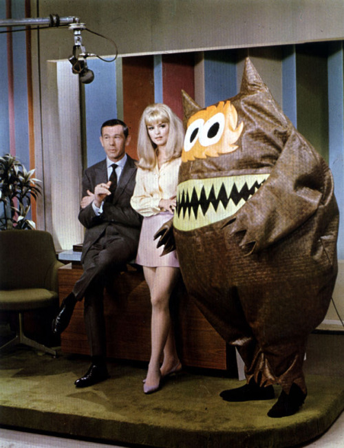 what-floats-my-boat:  Johnny Carson and The Nauga Monster (the mascot for naugahyde vinyl)1966?
