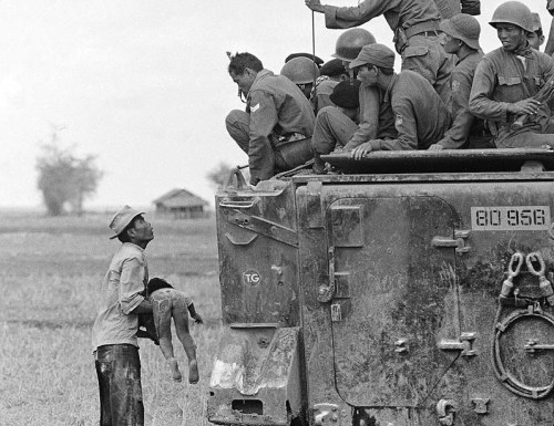 © Horst Faas / Associated Press, March 19, 1964, Vietnam In one of several photos that earned Faas the first of two Pulitzer Prizes, a father holds the body of his child as South Vietnamese Army Rangers look down from their armored vehicle. The child was killed as government forces pursued guerrillas into a village near the Cambodian border on March 19, 1964. Faas, a photographer who carved out new standards for covering war with a camera and became one of the world's legendary photojournalists in nearly half a century with the AP, died Thursday in Munich, said his daughter, Clare Faas. He was 79. (+) » find more war & conflict photography here «