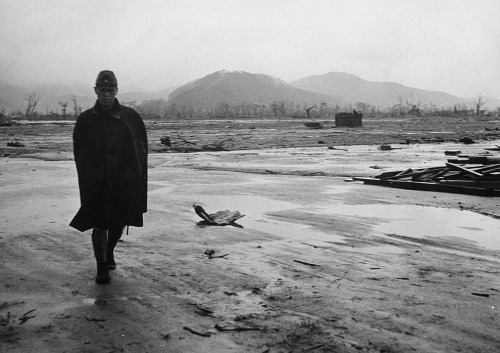 """A Japanese soldier walks through a leveled area in Hiroshima, Japan in September of 1945, one month after the detonation of a nuclear bomb above the city."" (U.S. Department of Navy)"