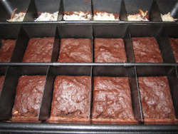 healthy-living101:  56 Calorie Brownies Ingredients3/4 cups whole wheat flour1/2 tsp baking powder1/4 ts salt1/2 cup apple sauce1/2 cup baking cocoa (will have to see if they sell dark chocolate in baking cocoa form)1/2 cup honey1 tsp vanilla3 tbsp egg whites (1 egg can also be used, however this will add cholesterol to your finished product)Mix ingredients & bake at 350 degrees F for 17-20 minutes.  Nutritional information:  Calories 56 Total Fat .4g Trans fat 0.0g Cholesterol 0mg Sodium 36mg Total Carbs 13.5g Dietary Fiber 1.0g Sugars 8.1g Protein 1.3g