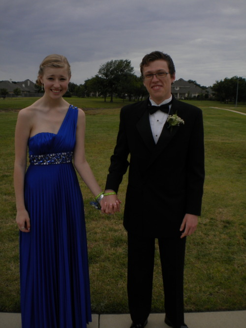fishingboatproceeds:  theyellowbirdie:  Nerdfighters going to Prom :)  The matching Esther bracelets!