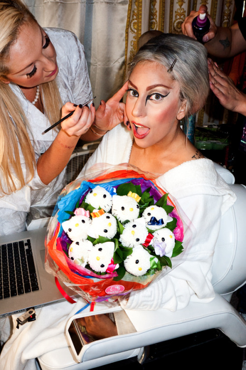 Gaga holding hello kitty flowers.