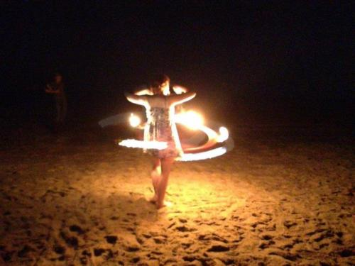 My ex, Kelly, spinning fire hoop for her first time as well.