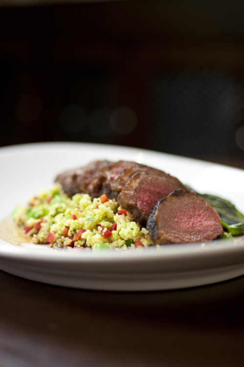 Pan Seared Lamb Loin with sweet pea couscous, red watercress, and lamb demi