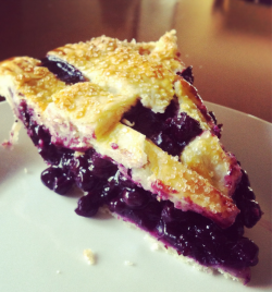"BLUEBERRY PIE I have a big book of pie recipes, but no one gives a damn. The people want what the people want and the people want Blueberry. (Or Apple.) The classics always win. I made this blueberry pie for Mother's Day. The recipe calls for fresh blueberries, which I'm sure is awesome, but I used frozen. In fact, I've only ever used frozen blueberries because you need 2 pounds worth. There's two and half bags of blueberries in this pie! (But they were on sale. Hah.) Maybe in the summer I'll take a road trip to St. Jacobs and buy a shit load of fresh fruit and bake my heart out.  A lattice top looks super fancy and complicated, but the weave is pretty easy once you get the hang of it. If you're making your pie dough from scratch (which you should) it'll be very delicate and annoying, much harder to handle than if you use store-bought dough, but it will also taste ten times better. I was looking for instructional videos on ""The YouTube"" to demonstrate the way to weave and it took forever, because so many people were doing it the hard way. The hell? I was thinking about making my own video, but I finally found a good one. Check out the link above and you'll be solid.  BLUEBERRY PIE All-purpose flour, for dustingPâte Brisée2 pounds (about 7 cups) fresh blueberries, picked over and rinsed ½ cup sugar¼ cup cornstarch¼ tsp ground cinnamon 1 tbsp freshly squeezed lemon juice1 large egg yolk, for egg wash 1 tbsp heavy cream, for egg wash Fine sanding sugar, for sprinkling Preheat oven to 400º F. On a lightly floured surface, roll out one disk of dough to a 13-inch round, about ⅛ inch thick. Fit dough into a 9-inch glass pie plate. In a large bowl, toss together berries, sugar, cornstarch, cinnamon, and lemon juice until combined. Pour mixture into pie plate, piling in centre. On a lightly floured surface, roll out remaining disk of dough. To make lattice, cut dough into ten 1-inch-wide strips using a fluted pastry wheel. Lightly bush edge of dough in pie plate with water. Carefully arrange dough strips on top, weaving to form a lattice. Trim dough to a 1-inch overhand. Fold edges under as desired, and crimp with a fork. In a small bowl, whisk together egg yolk and cream for egg wash; brush on top of dough strips and edge of pie shell. Generously sprinkle with sanding sugar. Refrigerate pie until firm, about 30 minutes. Transfer pie plate to a parchment-lined rimmed baking sheet, and bake until crust begins to brown, about 20 minutes. Reduce heat to 350ºF. Continue baking until crust is deep golden brown and juices bubble, 55 minutes more. (If crust browns too quickly, tent pit with foil.) Transfer pie to a wire rack; let cool completely at least 3 hours, before serving.  Source: Martha Stewart's Pies & Tarts"