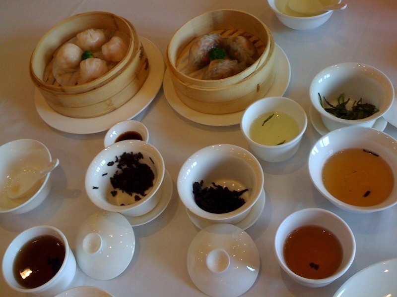 "tasting three different Chinese #teas with dim sum in Suzhou. Yesterday we went to a popular and reputable Cantonese style dim sum place in Suzhou and took a chance on their tea menu which yielded pleasantly surprising results!  While nicer restaurants always have a tea menu, the quality and ability to prepare it well is very spotty, can be very overpriced, and is basically like rolling the dice here in China.  Yes that is weird, because we are in the land and origin of tea itself, China, but the story of quality, consistency, trust and responsibility in food consumables in China is a whole other blog I'm not going to start with this post. Anyways, I was in a good mood, and since we were so close to famous tea growing regions (Suzhou being one for 碧螺春 biluochun), southern Chinese are more knowledgeable and acquainted with tea than their northern counterparts in general, fresh spring harvest teas should have flooded the market by this point, I was feeling adventurous and ready to roll the dice. The tea menu was reasonable enough—tightly edited selection of ""greatest hits"" of Chinese teas at fair prices.  It oddly did not have any locally grown selections (glaring omission: 碧螺春 biluochun) butit did quite predictably reflect the tea tastes of Cantonese tea drinkers which made sense since we were at a Cantonese style dim sum restaurant. We ordered three different teas by the cup, which each came in its own gaiwan and had a dedicated tea server (separate from the normal waitstaff) to brew and decant it for you.  It was a brilliantly simple set up which nicely reflected some basic respect for tea drinking.  The tea itself was better than we expected and I can't wait till more food establishments outside of China start using this tea service model as the norm to provide some decent tea with good food.  _____________________________________________________________________ If you enjoyed this article, sign up for Tranquil Tuesdays' newsletter to  Explore the stories behind each of Tranquil Tuesdays teas and teaware Travel with Tranquil Tuesdays seeking the best teas and teaware in China Learn the historical and cultural elements that make Chinese tea and teaware so unique Sign up for Tranquil Tuesdays' newsletter now!"