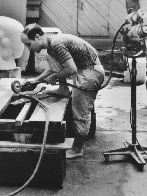 Isamu Noguchi polishing marble… with no shoes on. My hero.