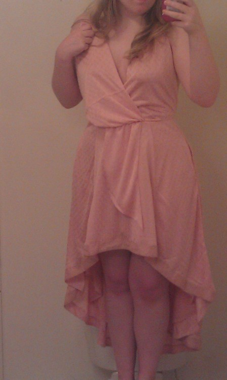 "36-29-40, 136 lb, 4' 10"". Dress by Free People."