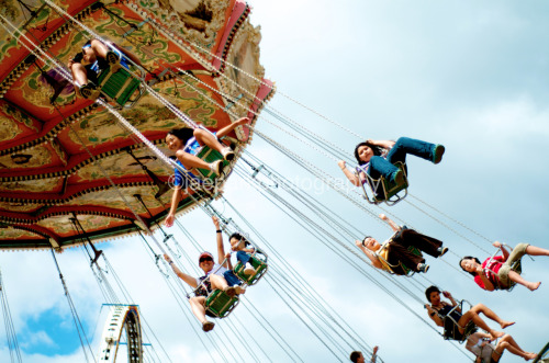 Joy in Flight.  Took this picture at the Punahou Carnival. The carnival draws thousands of people over the span of two days from all over Oahu.  The various rides are a huge draw to a lot of the people there as can be seen by the huge smiles (and looks of terror) on some of the people.  Taken with my Nikon D7000.