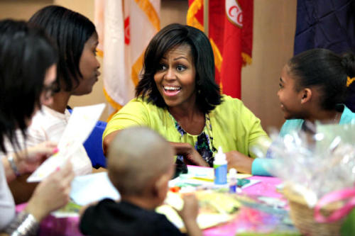 Photo of the Day First lady Michelle Obama participates in a celebration with military families and children at Walter Reed National Military Medical Center in Bethesda, Md. The Obamas' largest 2011 charitable gift, $117,130, was to a group that provides housing to military personnel and their families while they receive medical treatment. Read full story. Yuri Gripas/Reuters
