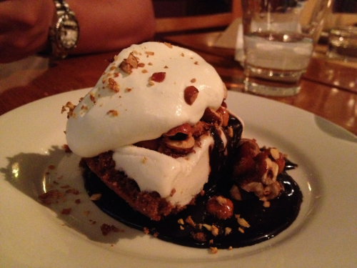 Banana Gelato Pie with chocolate almonds and hot fudge at Pizzeria Mozza. A side restaurant by famed chef Mario Batali and Joe Bastianich (you know, that bitchy/acid spitting judge on US Masterchef), is one of the few decent places to eat at Singapore'a Marina Bay Sands integrate resort.   The mains are pretty good. Of course, as the name of the establishment goes, the pizza is pretty decent. A real gourmet wood fire oven taste with delicious quality ingredients. But if you're looking for one of those cheese oozing, New York slice type, forget about it. It's pretty scant on cheese and looks pleasantly imperfect in a home-made sort of way.   But the real stunners of this place is the dessert. And this is my favorite. The banana gelato pie. Not overly sweet, and the almonds and thick fudge gives the dessert something to bite into. Crazy good, this.