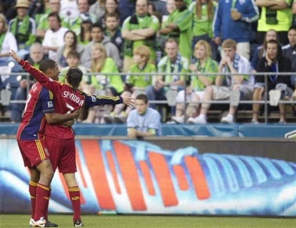 Real Salt Lake's Fabian Espindola, right, gets a hug from teammate Chris Schuler after Espindola scored a goal against the Seattle Souders FC during the second half of play in a MLS soccer match, Saturday, May 12, 2012, in Seattle. Real Salt Lake won the match 1-0.