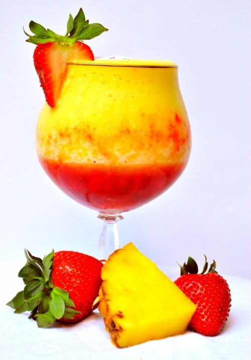 smidgetz:  Pineapple Upside Down Cake Daiquiri A classic dessert is blended into an icy crowd pleasing cocktail  What You Need 1 cup freshly frozen pineapple chunks 2 large fresh strawberries 2 splashes naturally sweetened pineapple-coconut or coconut sparkling water (Like La Croix) 2 handfuls crushed ice cubes 1 oz whipped cream vodka ½ oz pineapple rum   Get started! Muddle (or mash) the strawberries and spoon into the bottom of a glass. Add the remainder of the ingredients to a blender and blend until smooth. Carefully pour the pineapple mixture over the strawberries. Enjoy