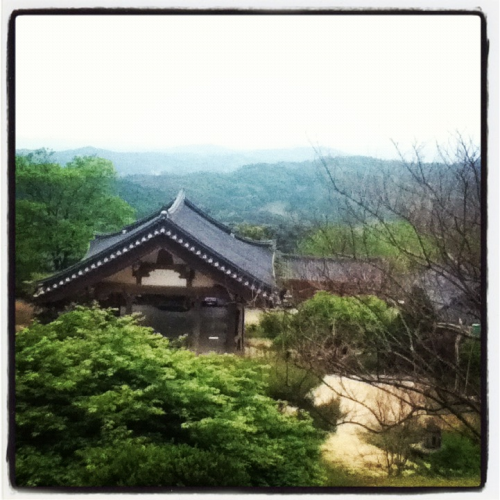 A beautiful view from the top of Buseoksa temple  It's unfortunate that I wasn't able to spend more time at the temple; one of the disadvantages of traveling with a tour group.  It was mentally refreshing just looking out at the mountains, and I'm sure I could have spent hours and hours lost in thought in such a serene place.    There's the one thing I've truly come to appreciate about temples.  The dynamic is so different and calming.  I wish there were places like this at home that I can easily go to to relieve my mental congestion.  Though it was tiring at the top, it was well worth the climb.  But as always, I took a thousand photos and none could do it justice.