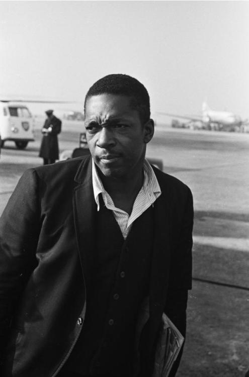John Coltrane arriving at Schiphol Airport in Amsterdam, 1963. Photo by Hugo van Gelderen.